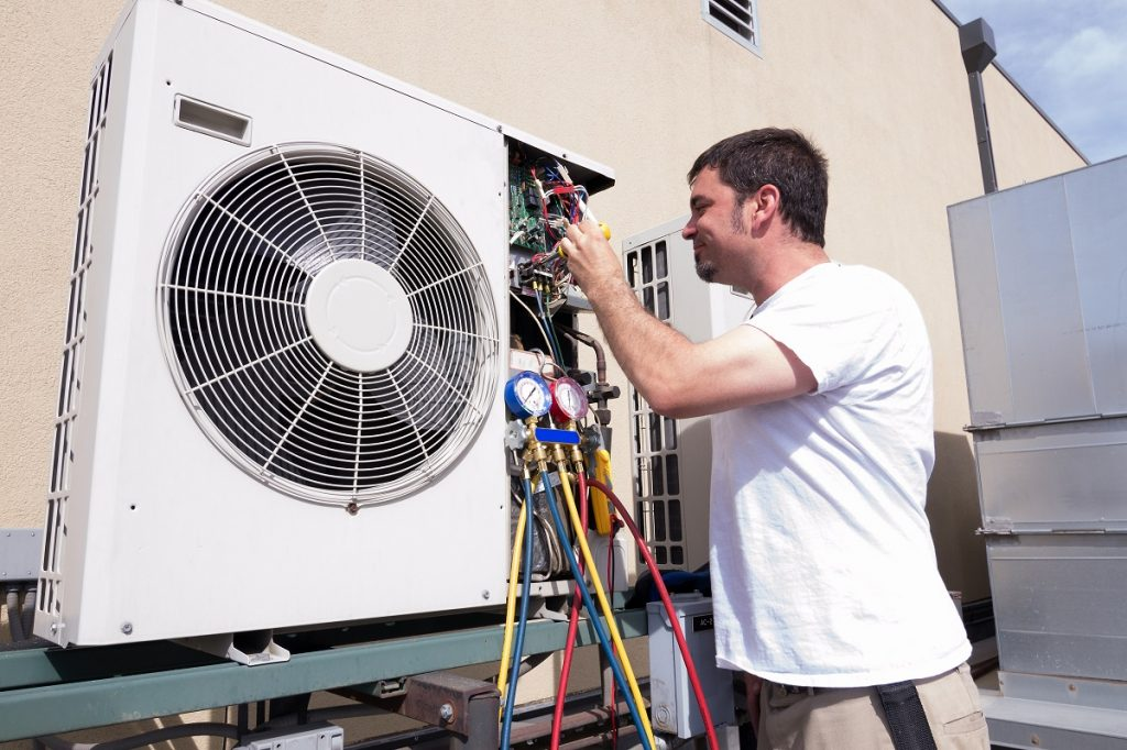 Technician working on an HVAC unit