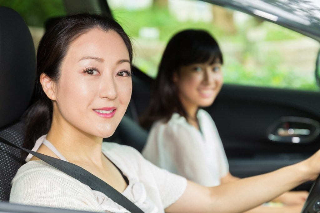 Mother teaching daughter to drive