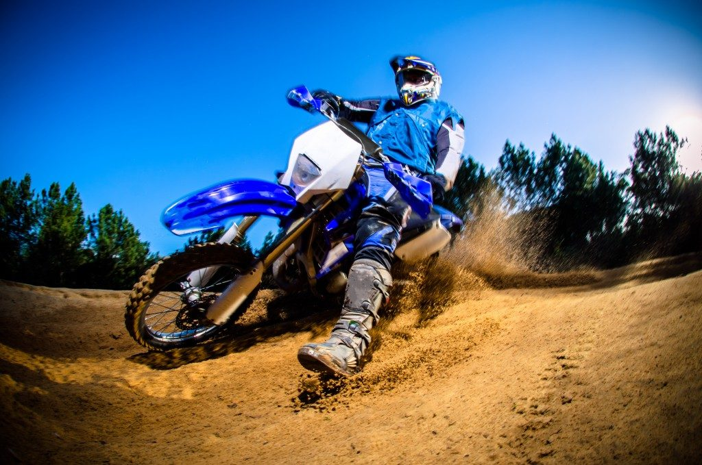 Motor bike rider on san terrain