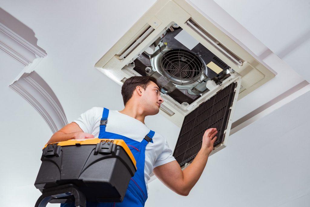 Man checking airconditioning unit