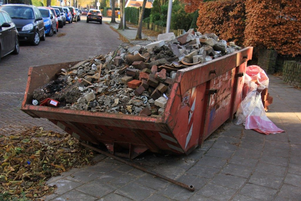 Loaded dumpster near a construction site