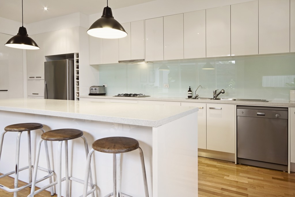contemporary kitchen with island and bar stools