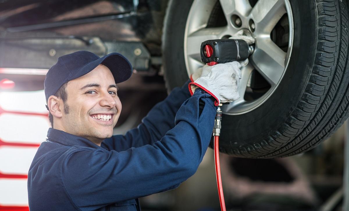 man repairing wheels