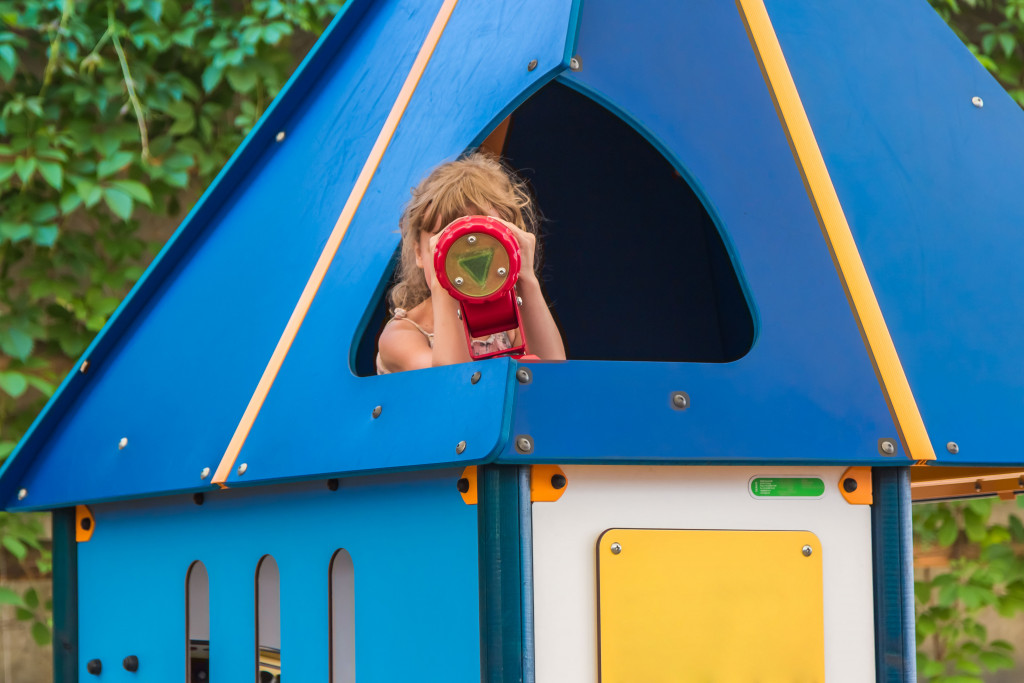 kid in a playset house